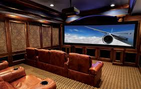 themed family rooms interior home theater: home theater in basement several little ceiling lamps movie poster wall art awesome wall theme brown color leather reclining chairs modern tv wall