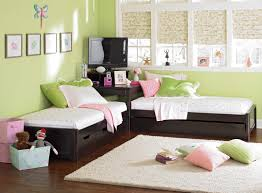 exciting light green wall colors interior design kids bedroom featuring large glass window and dark brown bedroom furniture corner units