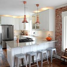 image of amazing kitchen counter pendant lights in polished copper finish and white wooden kitchen cabinets amazing pendant lighting