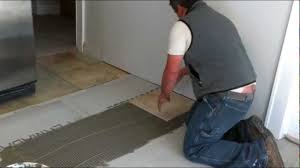 Laying Kitchen Floor Tiles How To Install Ceramic Tiles On A Floor Youtube