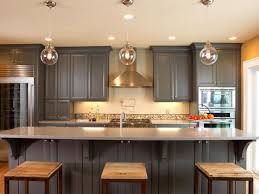 gel stain kitchen cabinets: gel stain kitchen cabinets white polished oak wood cabinets single rectangle porcelain sink floate tv on wall standard eased edge white granite countertop