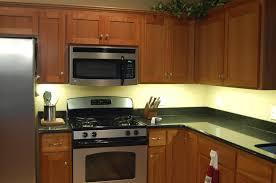 sleek backsplash tile and awesome under cabinet lighting feat laminate stone countertop design cabinet lighting backsplash home
