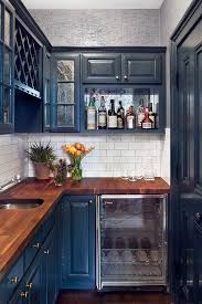 small kitchens can handle deep blue cabinets when the walls are painted a light neutral shade blue cabinet kitchen lighting