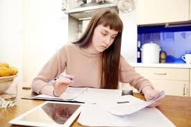 late teens girl studying writing a legal cover letter