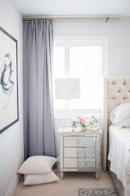 ideas for bedroom curtains feminine bedroom with violet curtains a creme upholstered headboard an