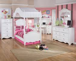 amazing white wood furniture sets modern design: interior white wooden canopy bed with pink brown stripped bedding set placed on the brown wooden