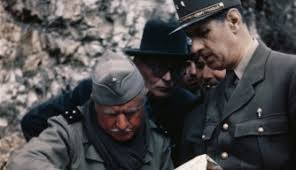 charles-de-gaulle-looking-over-map - Allied Military Leaders Pictures