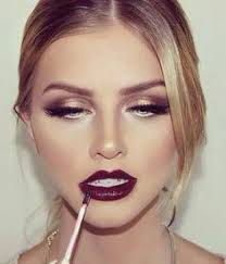 white black and gold makeup with dark burgundy lips such a dramatic look for fall winter