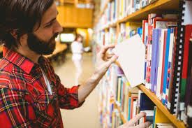 how to write an undergraduate essay essay structure reading and man beard in library choosing a small book from a shelf
