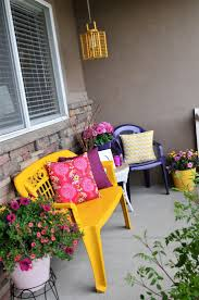 previous pinner love this idea of spray painting cheap plastic furniture bright colors sr the bright colored pillows make a difference and add many cheap plastic patio furniture