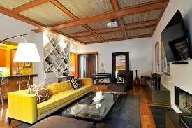 bright couch cushion covers in family room contemporary with textured ceiling next to long sofa alongside yellow sofa and yellow couch bright yellow sofa living