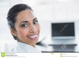 beautiful smiling businesswoman sitting in bright office beautiful bright office