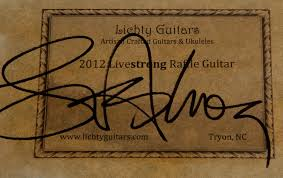 armstrong signs lichty guitar for raffle lichty guitars lance armstrong signs lichty guitar for upcoming raffle