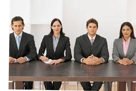 how to survive the nerves of an interview morecambe news events front view portrait of four business executives sitting in a line image by