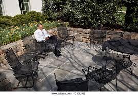 president barack obama sits alone on the patio outside the oval office stock image barack obama enters oval