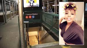 Young Mother Holding Stroller With <b>Baby</b> in It Falls <b>Down</b> Subway ...