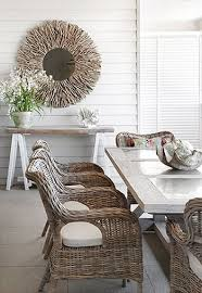 rattan furniture and white cladding are great for a beach house look white beach furniture