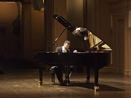 who is the pianist looking in the popular culture mirror can we call all of the people who can play piano pianist it s not about how adept at playing the piano skill of that person has