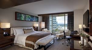 fairmont pacific rim example of a mid sized trendy guest bedroom design in vancouver with beige bedroom interior furniture