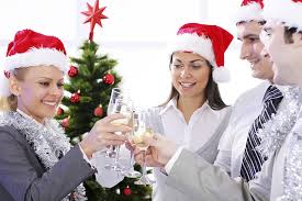 great seasonal jobs and how to get hired for them four people drink wine together during the holidays