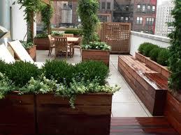 lighting beside wooden plants cover sleeper chair beside flower elegant living space urban city roof terrace amazing garden lighting flower