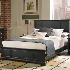 matte black polished wooden bed frame with accent panel headboard using white bed sheet added blue bedding for black furniture