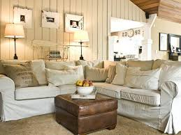 shabby chic living room with white slipcovered sofa and vintage leather stool chic living room leather