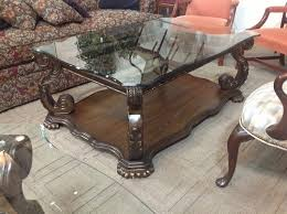 vintage rectangular coffee table from ashley furniture with artistic carving wood frame and glass surface in artistic wood pieces design
