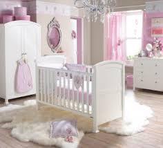 baby nursery view in gallery light brown wall silver chandelier piles carpet white bedding dresser cupboard baby girl nursery furniture