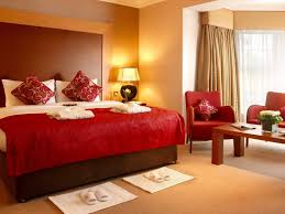 nice red cover master bed sheet with red fabric armchairs also wooden table plus white bedroom bedroombreathtaking stunning red black white