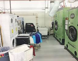 the laundry and drycleaning departments are located side by side in the mw cleaners plant providing staff flexibility as well as efficient work flow laundry presser