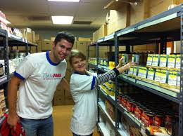 page my fisher grad life matt and maria restocking the shelves at the salvation army food pantry