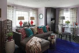 colorful cushions on grey sofa chais inside sitting room using bohemian interior design with round tables bohemian living room furniture