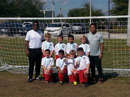 raiders at the festival northeast raiders youth association proud of those medals u9 boys head coach phanom phanamath and academy director gerald morin