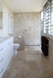 ideas bathroom tile color cream neutral: neutral bathroom designs for calming your moods bright decoration bathroom with large windows design with marble tiling accent and white cabinets also sink
