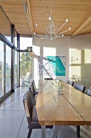 stinson beach house mid sized coastal great room photo in san francisco with concrete floors and buy matrix mid office