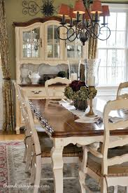 dining room table decoration dark tabletop with cream base and cream chairs with fabric seat middot