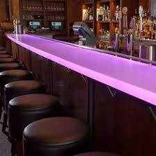 the main focal point of this urban contemporary restaurant is the chroma bar top with integral led lighting allowing for a myriad of colors to compliment bar top lighting