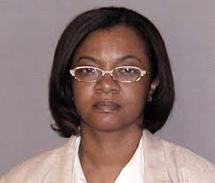 Convicted felon Monica Conyers will resign from the Detroit City Council effective July 6, the Associated Press is reporting. - monica-conyers-booking-photo-detroit-city-council