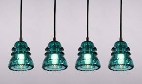 sold industrial pendant lights made from antique glass insulators darkened brass fittings antique pendant lighting