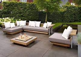 modern patio set outdoor decor inspiration wooden: innovative patio pads for chairs and low profile modern sectional sofas and large square wooden coffee table on top of dark grey concrete paving sl