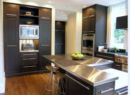 black and stainless kitchen view in gallery stainless steel countertops brighten a kitchen with black cabinetry