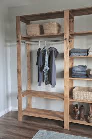 industrial style wood slat closet system with galvanized pipes ana white build office