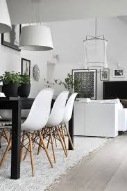 black and white dining table set: eames chairs and parker dining table gorgeous interiors pinterest table and chairs teak table and eames