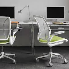 green office desk. two desks with green chairs office desk