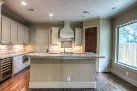 appointed with custom site built cabinetry granite counter tops recessed lighting and a large picture window allowing natural light to fill the space allowing natural light fill