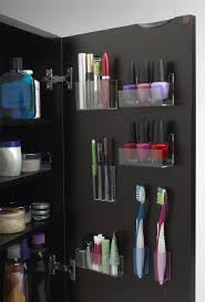 bathroom drawer organization: organize your cabinet doors with these clever stick on containers
