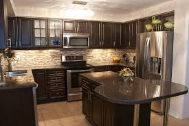 kitchen cabinets with granite countertops: granite countertops beige ceramic flooring kitchen ideas black appliances modern light brown cabinets white painted cabinetry beige stone backsplash