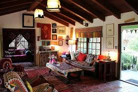 view in gallery bohemian living room clad in a wide variety of hues and overlapping rugs bohemian style living room