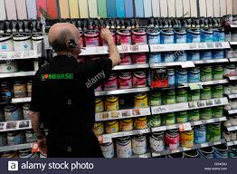 a s assistant tidies up a shelf of paint at a homebase store a s assistant tidies up a shelf of paint at a homebase store in aylesford south east england 1 2013 home retail britain s biggest household